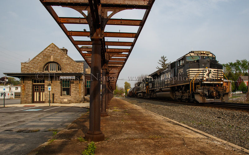 A westbound Norfolk Southern freight passes by Wernersville, PA station.